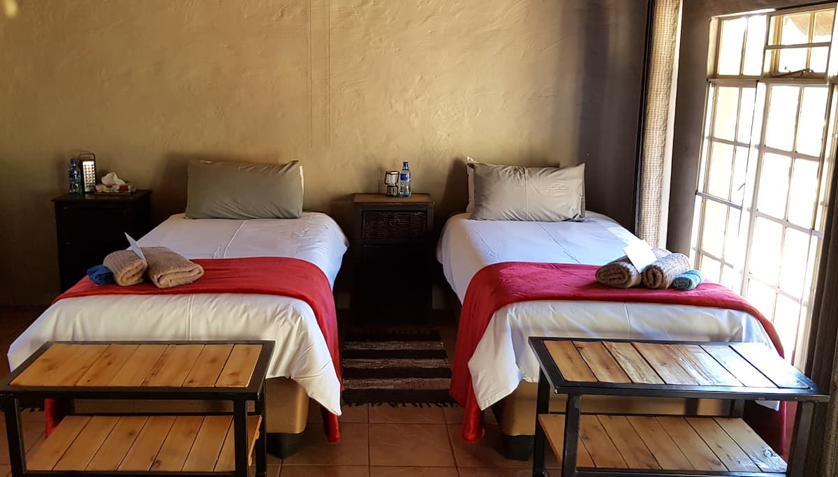 Safari in Südafrika, ChaZen privates Wildreservat: Betten im Chalet Sable. Foto: Lena Ziehres